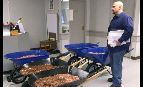 Man gives his two cents, pays DMV with 300,000 pennies