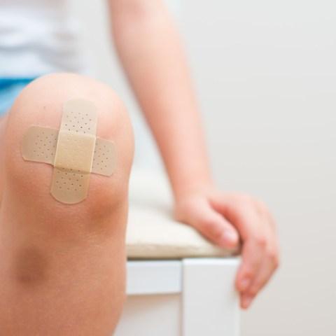Child's knee with bandage