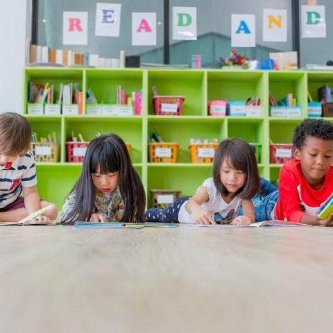 kids reading books in school classroom