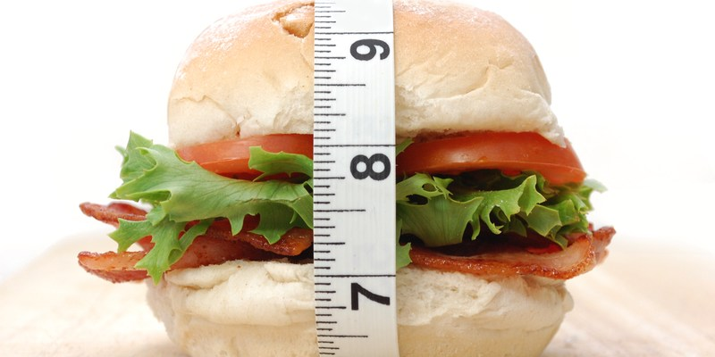 Bacon roll sandwich with measuring tape