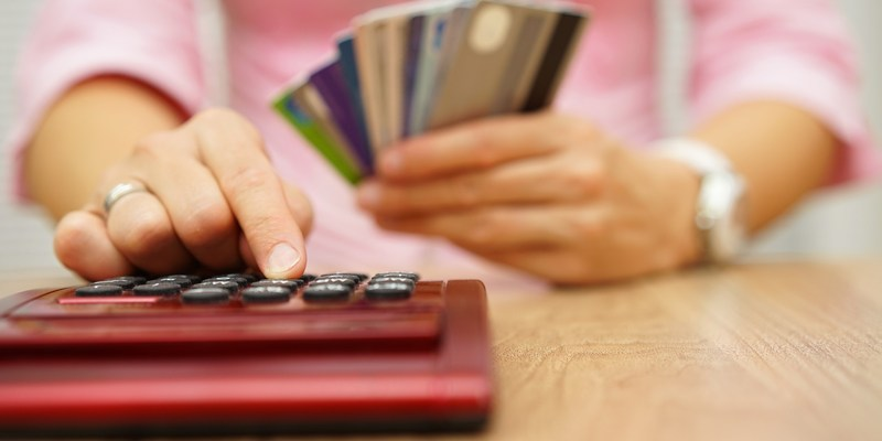 Woman with credit cards and calculator