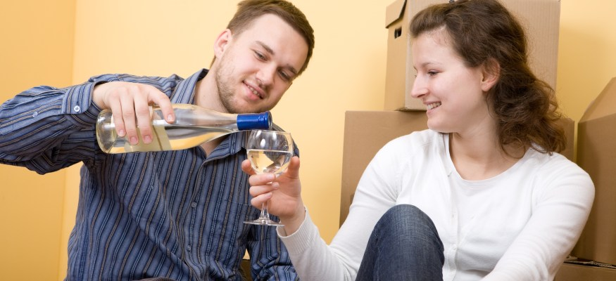 happy casual couple in new home via Dreamstime.