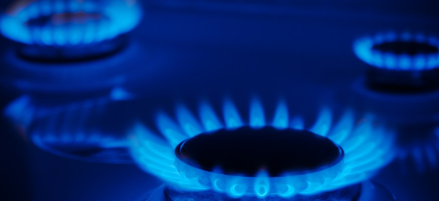Natural gas flame burning on stove top