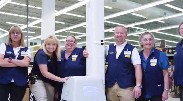 Walmart employees with shelf-scanning robot