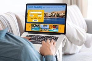 Hotel booking on computer - 6 popular items you're wasting big money on