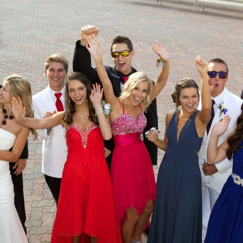 A group of teens pose for prom