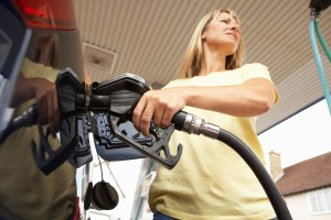 Woman fueling up vehicle