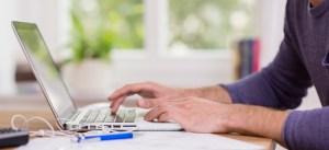 MTurk man typing on a computer