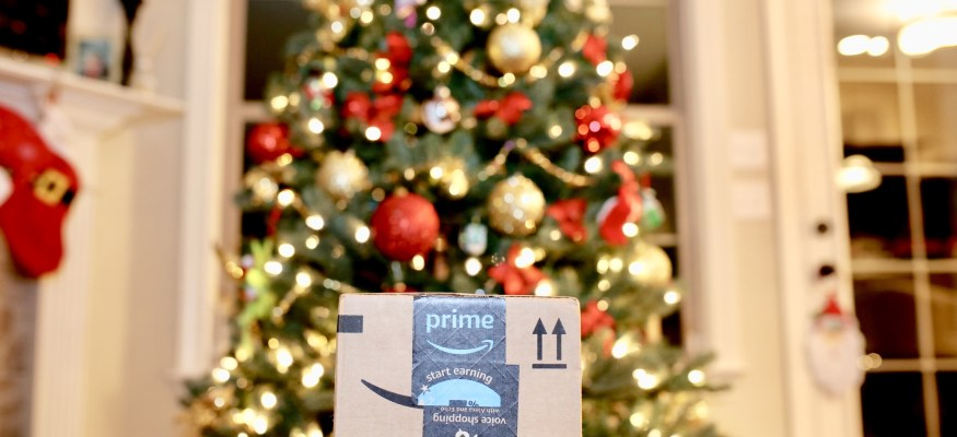 amazon package in front of christmas tree