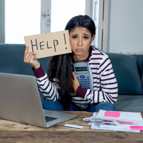 financially stressed out woman with help sign