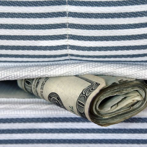Money under mattress at home