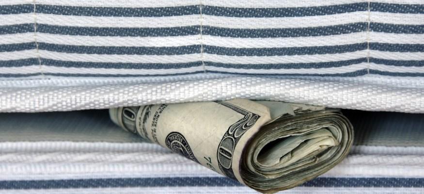 Money under mattress at home