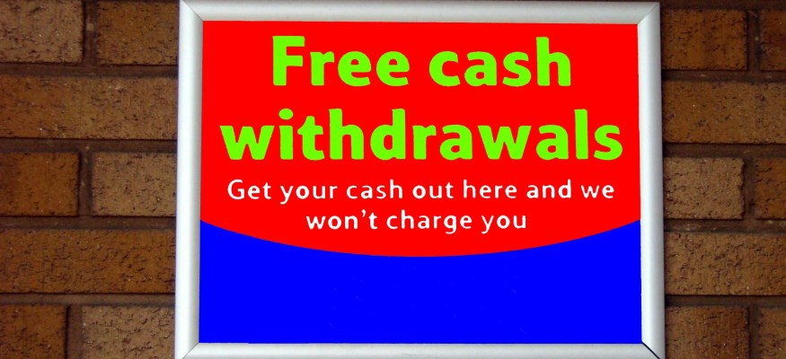 Free cash withdrawals sign for an ATM