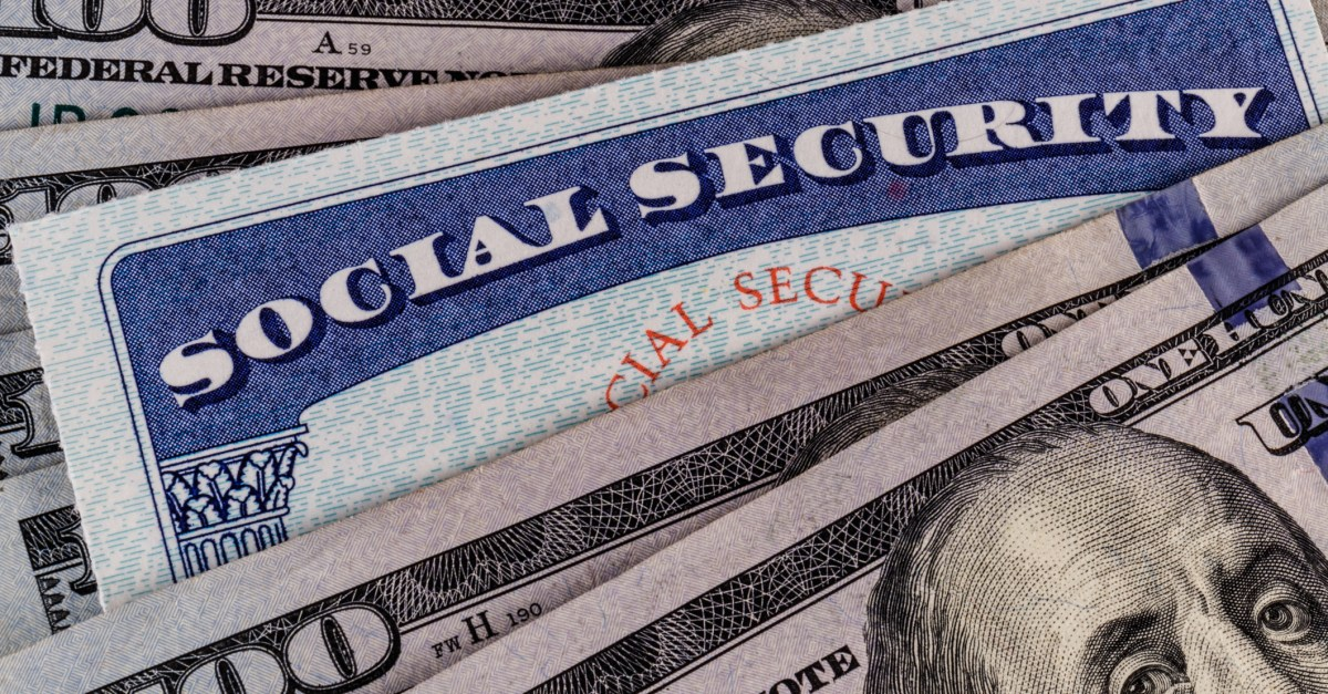 Social Security card with $100 bills