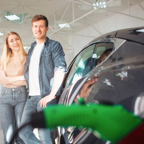 Couple buying an electric vehicle