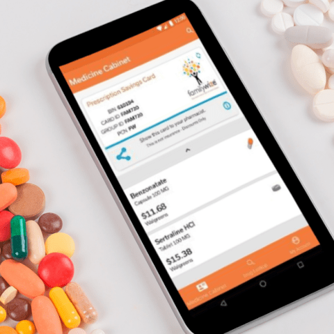 FamilyWize app on smartphone in the pharmacy with prescription drugs