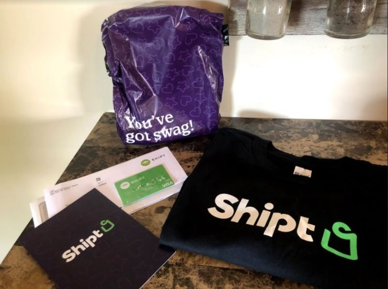 Shipt welcome package including a free shirt and a Shipt credit card