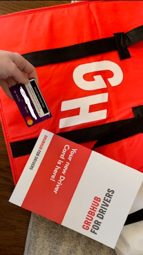 Grubhub's welcome kit including an insulated bag and driver card