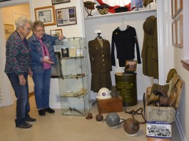 Two Rivers Heritage Musuem docents Jeri Beck and Marlene Nau at new display