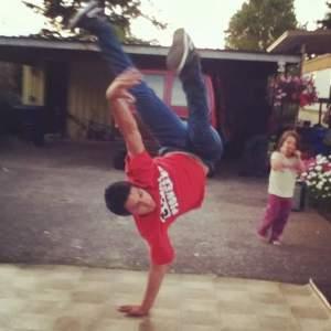 Lopez, in his early teens, frozen mid-handstand