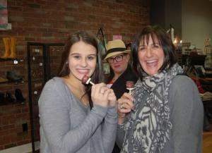 Downtown Camas Association Holly Matthews and Ann Matthews from Arktana with photo bomber Kimberly Koch