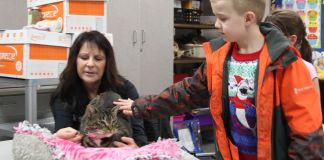 WCGHS - Cape project Cathi Parent, student Braden Long, and Purrgie the cat