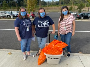 Columbia River Gorge Elementary Sydney Termini, Allison McGranahan and Taryn Tedford ready to distribute first grade learning supplies