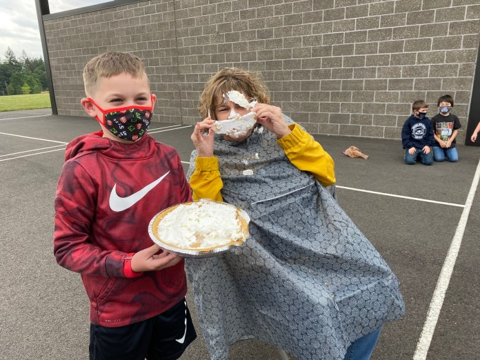 Columbia River Gorge Elementary First grader, Jase Kenyon, with Tracey MacLauchlan