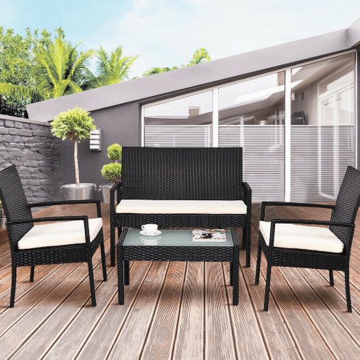 Costway 4-piece patio rattan wicker chair sofa table set for $136