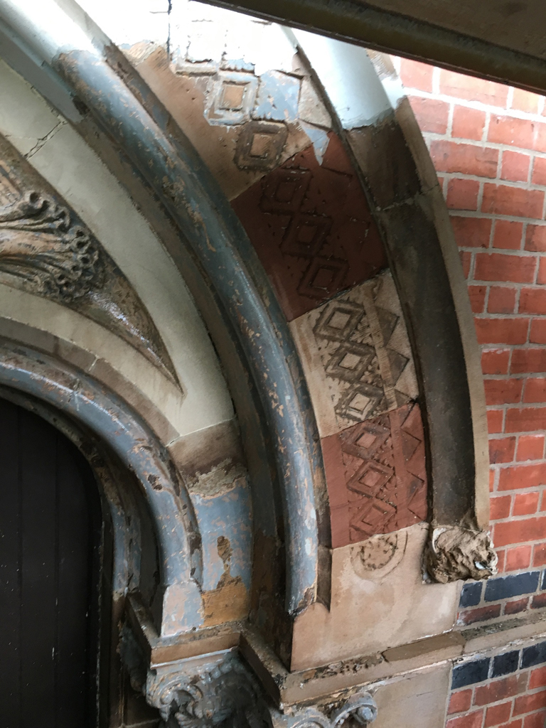 Paint being stripped at the entrance of St Mary's Church Belfast