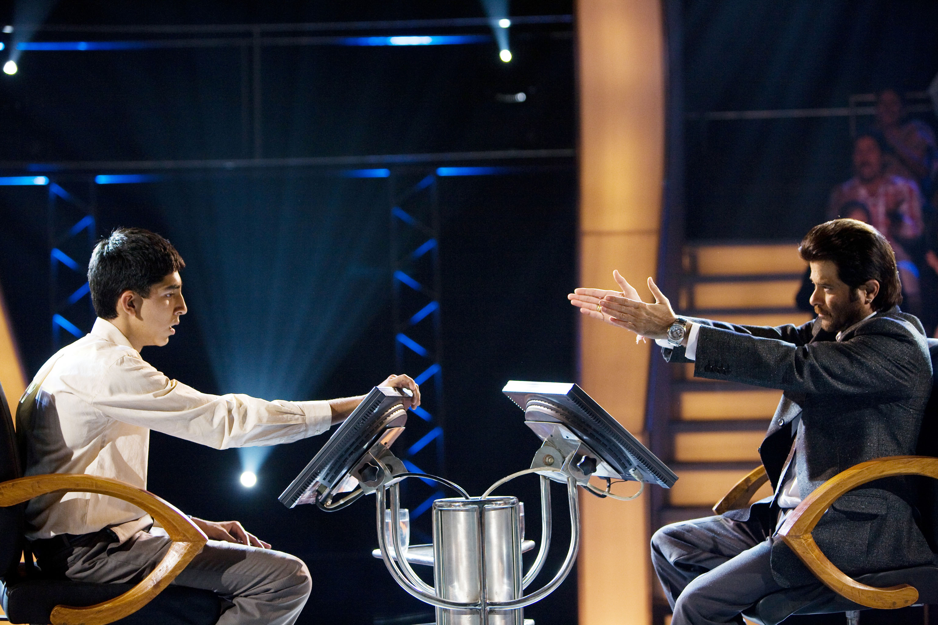 """Dev Patel, left, does his best to field questions from Anil Kapoor in """"Slumdog Millionaire,"""" the 2008 winner of Oscar's best picture award."""