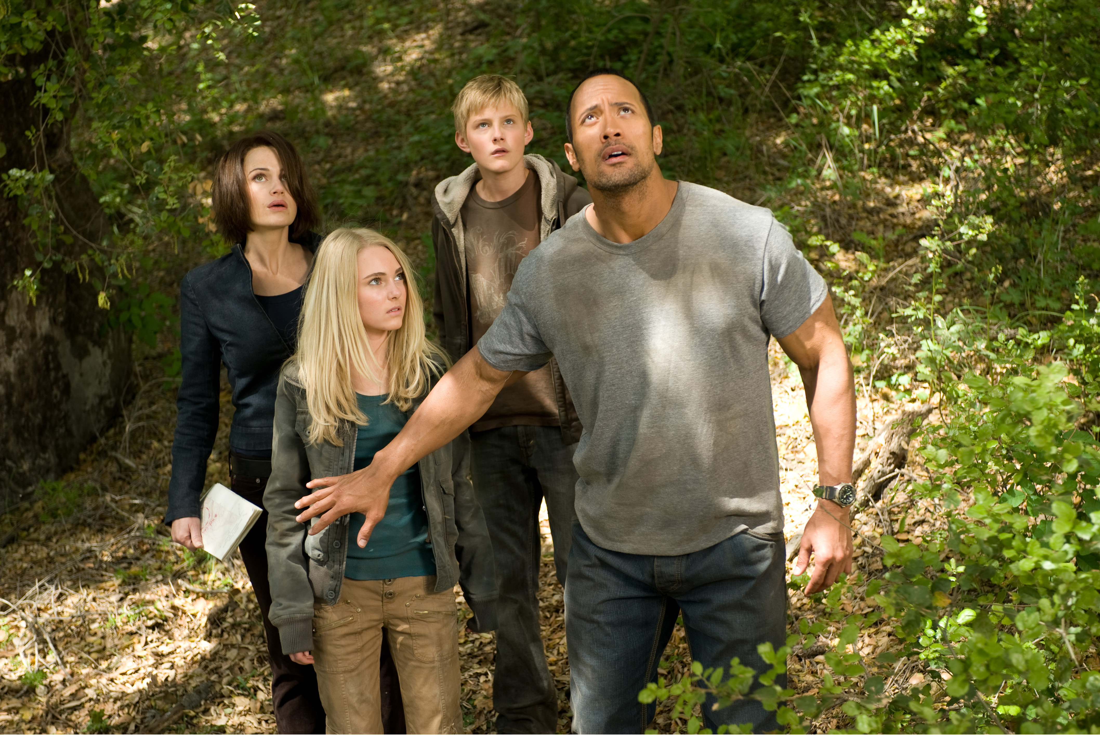 """From left to right, Carla Gugino, AnnaSophia Robb, Alexander Ludwig and Dwayne Johnson in """"Race to Witch Mountain."""""""