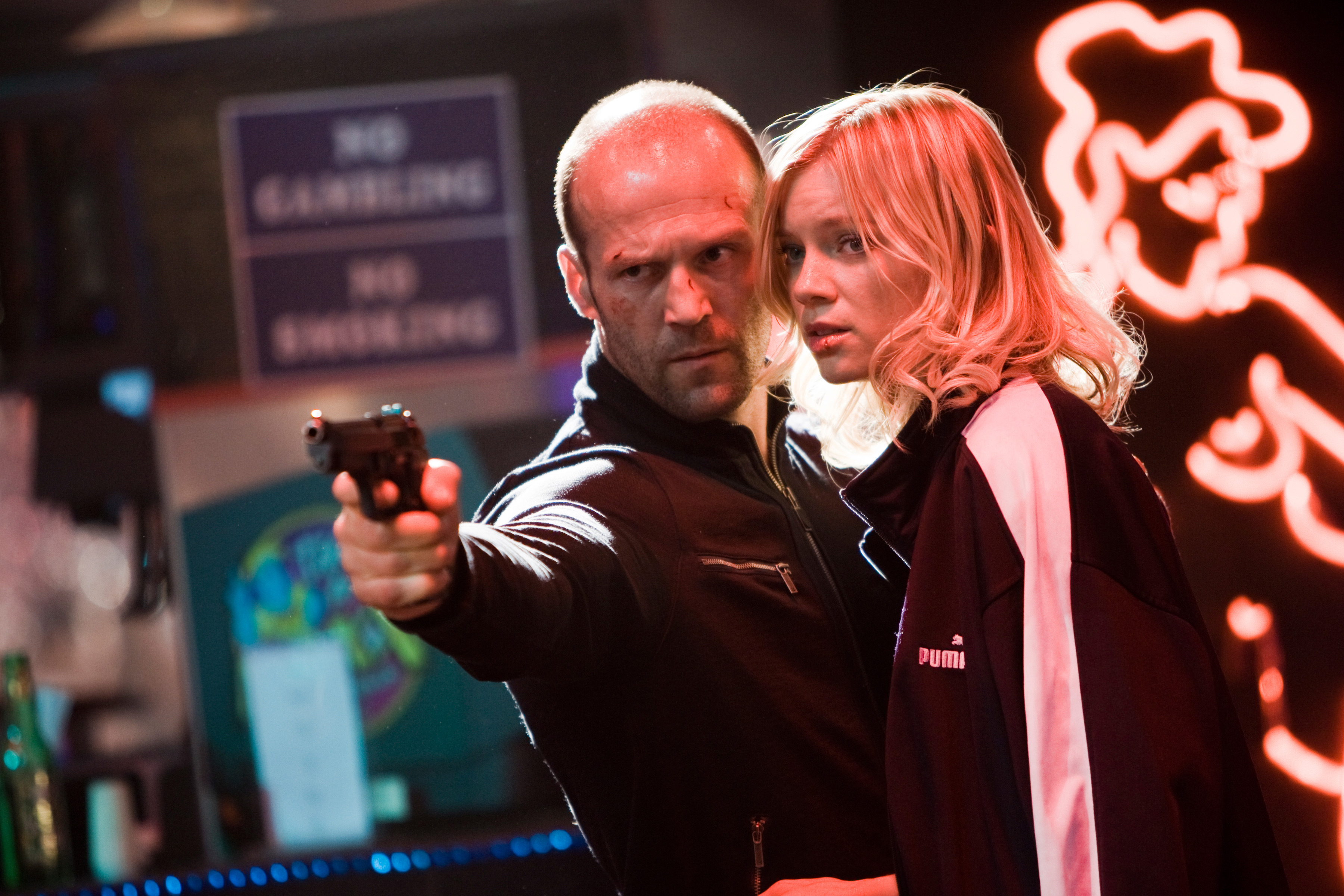 """Chev Chelios (Jason Statham) and his girlfriend, Eve (Amy Smart), get down and dirty in the action film """"Crank 2: High Voltage."""""""