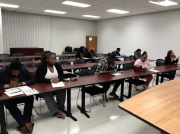 Students wait for class to start at the 1st Chawla Hospitality Academy class at the Workforce Development Center.