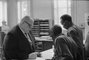 Circuit Clerk Theron Lynd with voter registration applicants in Hattiesburg, Mississippi, January 22, 1964. (Photo from Moncrief Photograph Collection, MDAH)