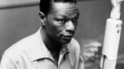 Nat King Cole attacked on stage in Birmingham.