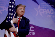Trump hugging American flag.