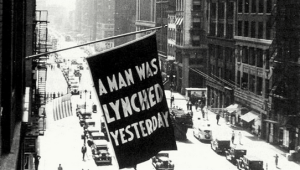 "Hanging sign, ""A Man was Lynched Yesterday."""