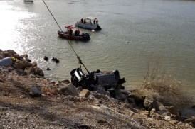 Crews remove a car from the Cumberland River on Sunday, Dec. 27, 2020. (CPD Detective Michael Patterson, Contributed)