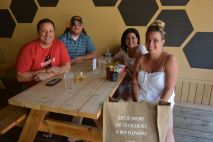 Customers who have been shopping in downtown Clarksville take a break and savor a glass of mead at Trazo Meadery, 116 Franklin St. downtown of Clarksville in May 2021 (Lee Erwin).