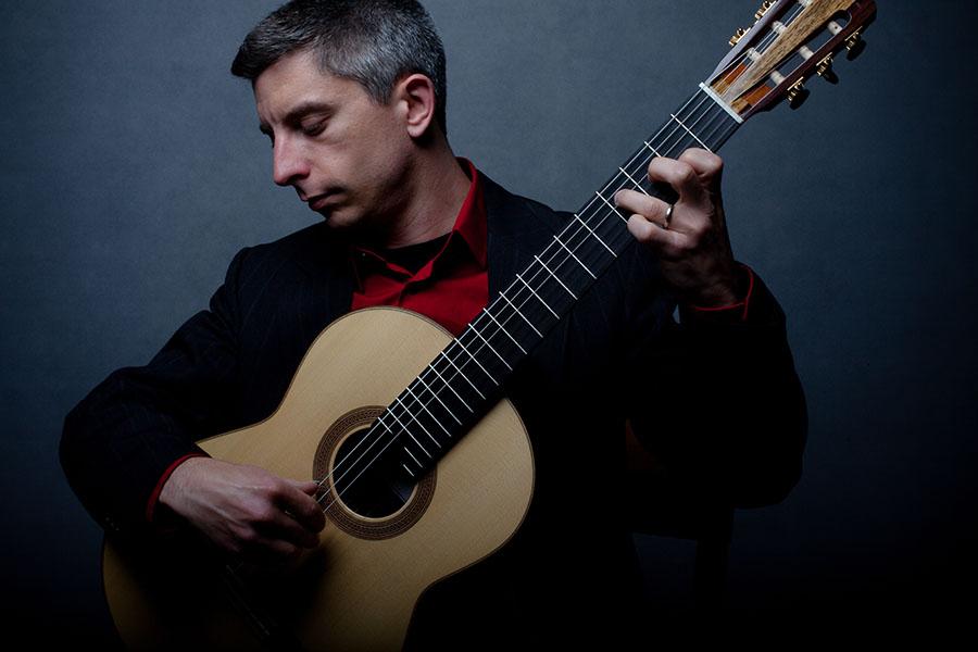 Kevin-J-Cope-playing-Douglass-Scott-Guitar-credit-Brian-Mengini