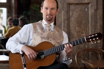 Classical guitarist Jan Depreter holding guitar