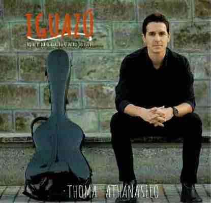 The cover of classical guitarist Thomas Athanaselos' album Iguazu. Athanaselos sits on a bench next to his guitar case.