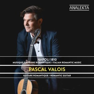 Classical guitarist Pascal Valois in a suit with his guitar on the cover of his album Napoli 1810