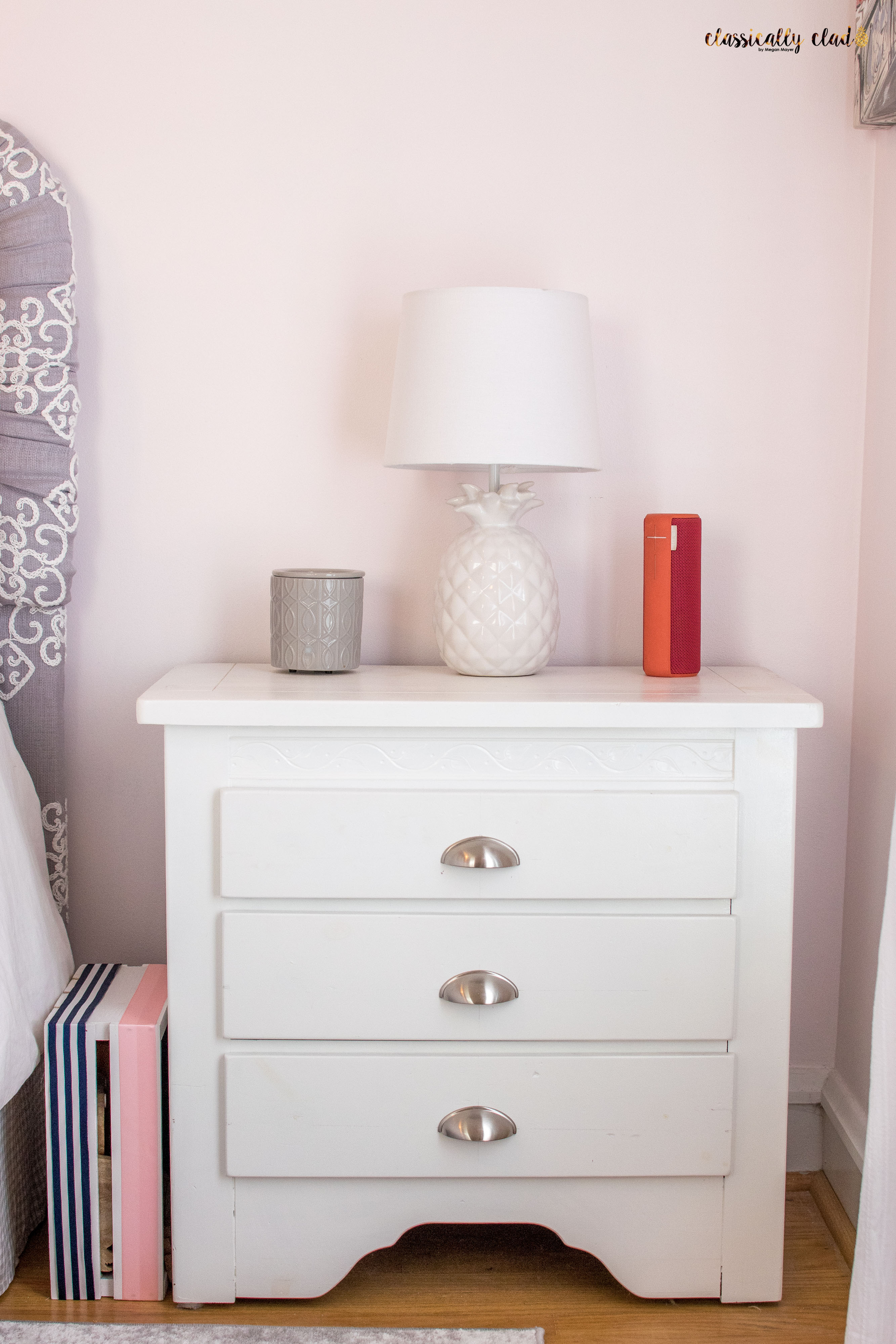 White nightstand and a white pineapple lamp