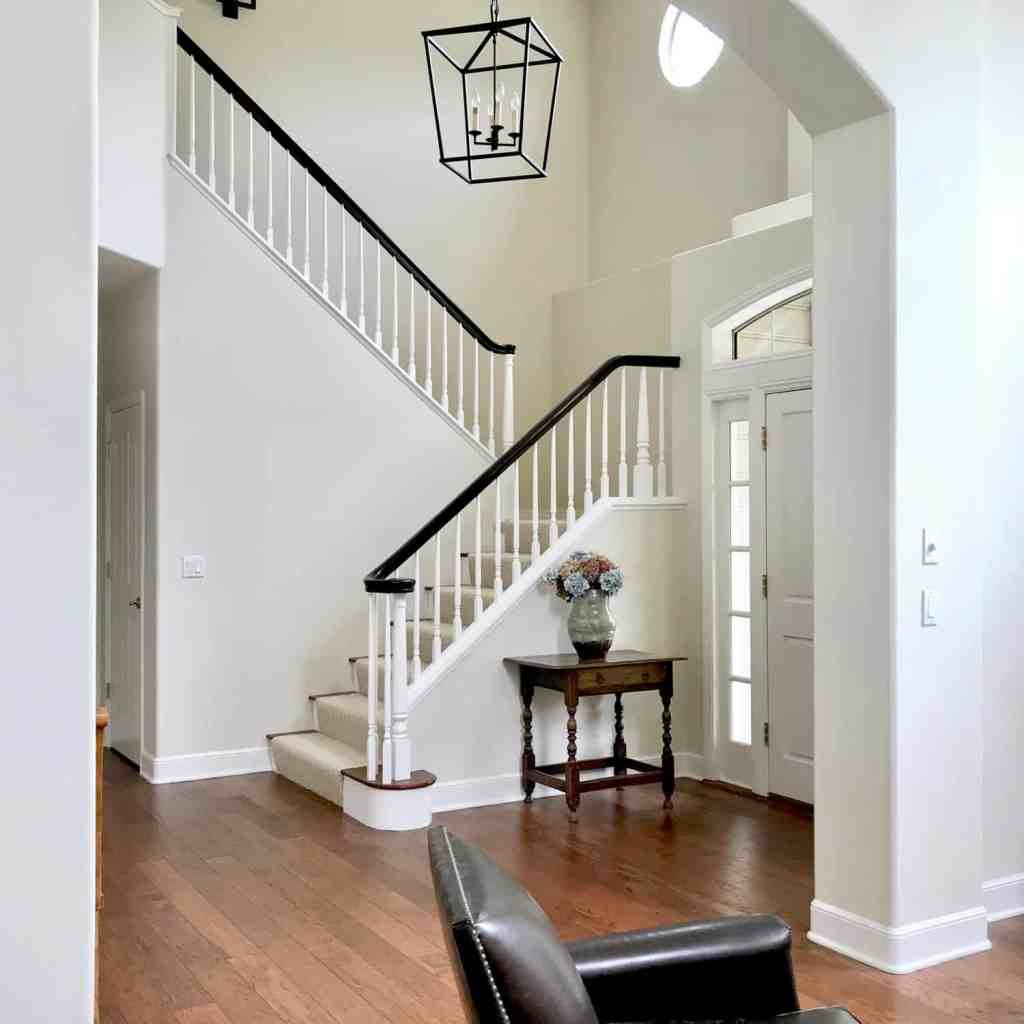 darkly stained banister and Darlana foyer lantern