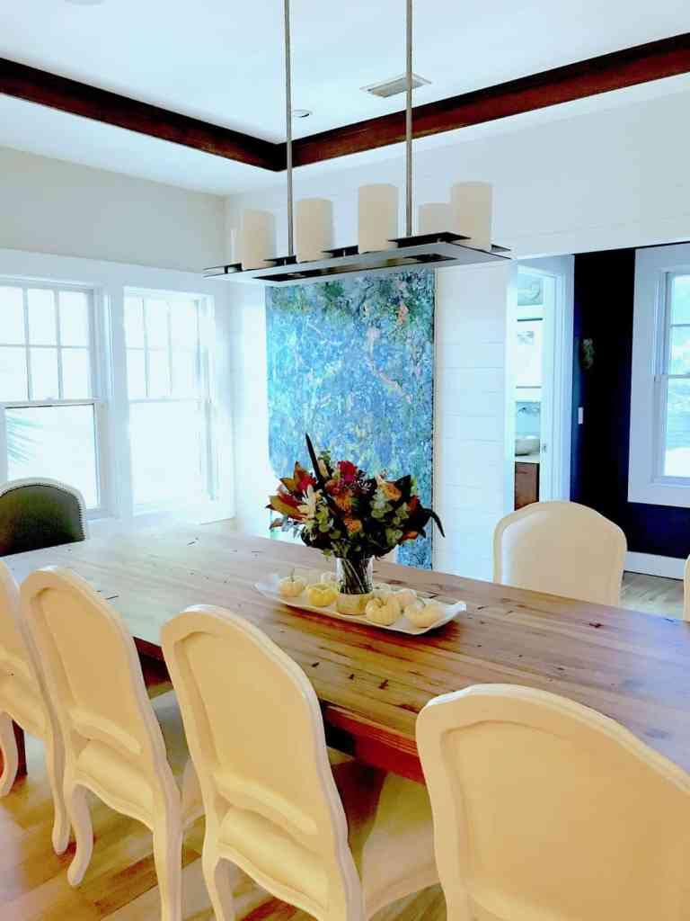 Dining Room with art and white chairs