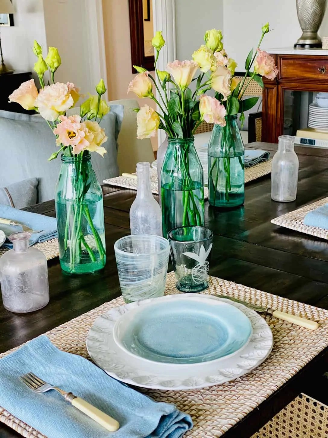 white washed place mats with aqua napkins and plates