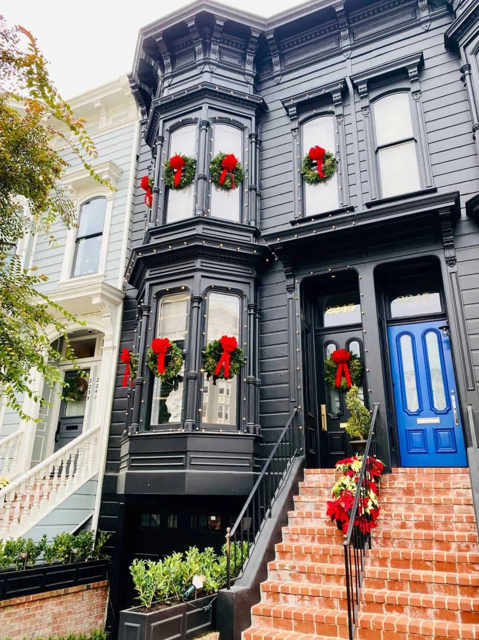 Black Victorian Home with Christmas Wreaths