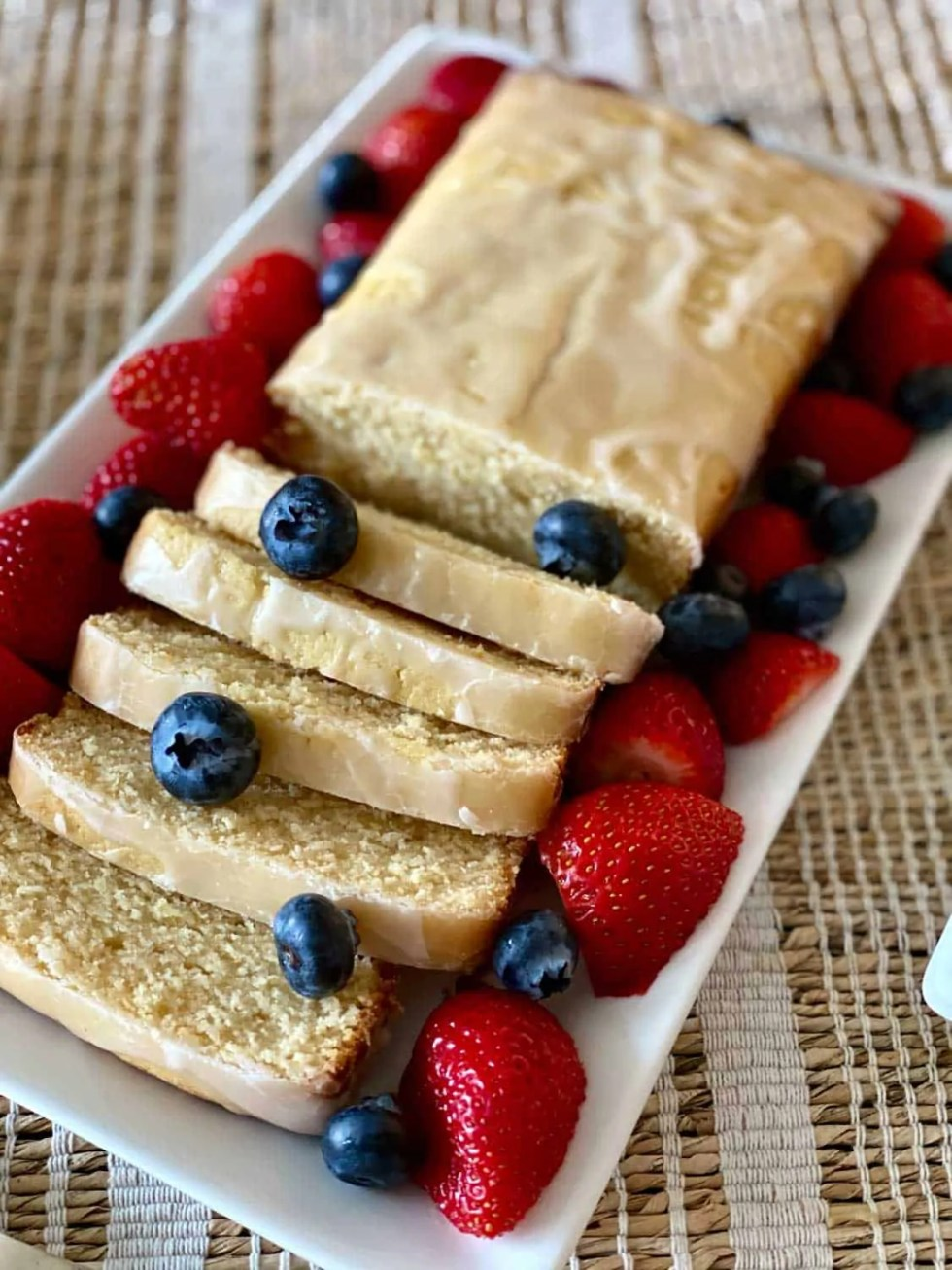 close up of sliced Lemon Cake with berries
